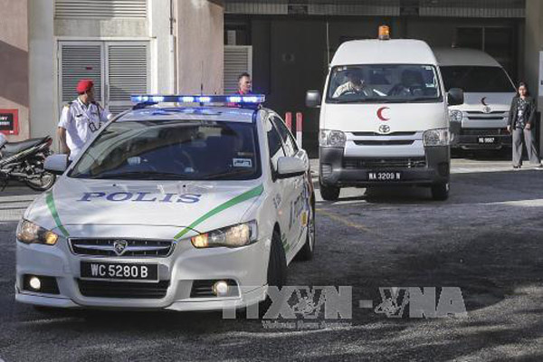 Xe cảnh sát và xe cứu thương mang thi thể ông Kim Jong-nam rời bệnh viện ở Putrajaya, Malaysia. Ảnh tư liệu: EPA/TTXVN